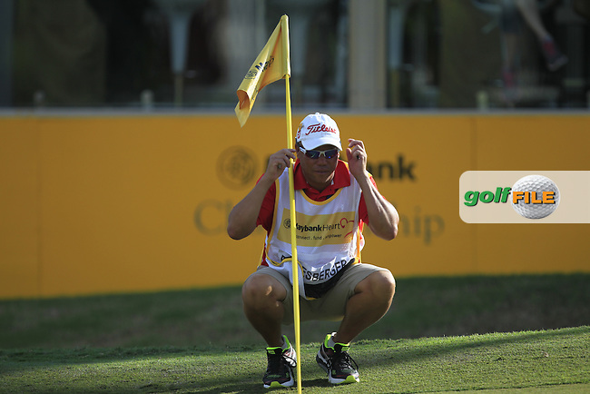 Shane reading the line for Bernd Wiesberger (GER) on the 18th green during Round 2 of the Maybank Championship on Friday 10th February 2017.<br /> Picture:  Thos Caffrey / Golffile<br /> <br /> All photo usage must carry mandatory copyright credit     (&copy; Golffile | Thos Caffrey)