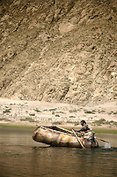 """In the Tibetan language, junba means """"fishing or catching."""" For generations, villagers in Junba have sustained themselves almost entirely by fishing the Lhasa and Tsangpo Rivers in these unique boats made from six to eight bull skins.."""