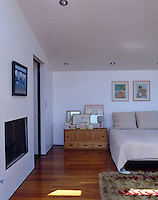 The contemporary master bedroom is spacious and airy and neutrally furnished
