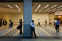 Commuters use telephones in one of the entrances to Shibuya station in Shibuya, Tokyo, Japan Friday July 20th 2018