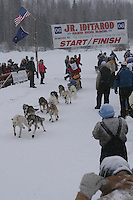 Dustin Regar  leaves the start line of the 2006 Jr. Iditarod race from Willow Lake, Alaska   ..Photo by Ben Schultz