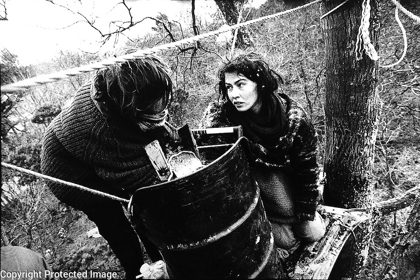 Newbury Bypass. 1996<br /> Protesters lock themselves on to a concrete filled barrel suspended in the trees.<br /> &copy;Andrew Testa/Panos