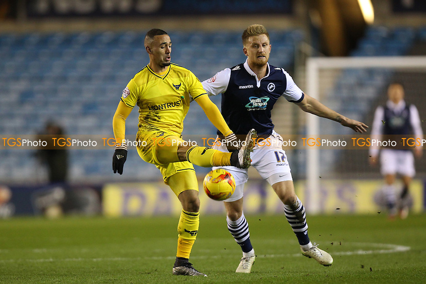 Kemar Roofe of Oxford United battles for possession with Byron Webster of Millwall during Millwall vs Oxford United at The Den