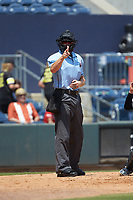 Home plate umpire Chris Graham makes a strike call during the International League game between the Scranton/Wilkes-Barre RailRiders and the Gwinnett Stripers at Coolray Field on August 18, 2019 in Lawrenceville, Georgia. The RailRiders defeated the Stripers 9-3. (Brian Westerholt/Four Seam Images)
