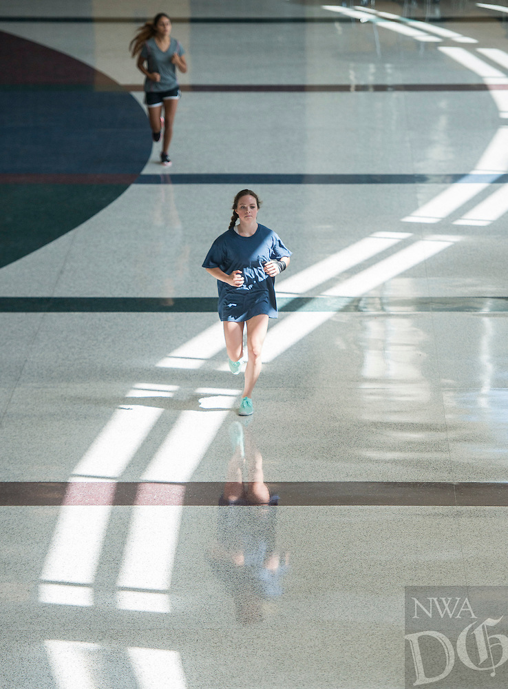 NWA Democrat-Gazette/ANTHONY REYES &bull; @NWATONYR<br /> Kate Nunley, 15, (bottom) Rogers sophomore, and Lexi Rodriguez, 16, Rogers senior, participate in conditioning exercises Thursday Aug. 4, 2016 at Rogers High School. Nunley, who is a cheerleader, and Rodriguez, who is on the dance team, had to make up for a conditioning session they had missed earlier in the summer after their practice.