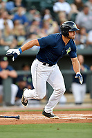 Left fielder Tim Tebow (15) of the Columbia Fireflies bats in a game against  the West Virginia Power on Thursday, May 18, 2017, at Spirit Communications Park in Columbia, South Carolina. Columbia won in 10 innings, 3-2. (Tom Priddy/Four Seam Images)