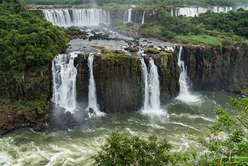 Iguazu Falls National Park in Argentina, as viewed from Brazil.  A UNESCO World Heritage Site.  Pictured is Rivadavia Falls at top with the Three Musketeers Falls or Salto Tres Mosqueteros below.  At top right are the San Martin and Mbigua Falls.