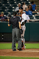 Bowie Baysox catcher Martin Cervenka (13) talks with home plate umpire Derek Gonzales during the second game of a doubleheader against the Trenton Thunder on June 13, 2018 at Prince George's Stadium in Bowie, Maryland.  Bowie defeated Trenton 10-1.  (Mike Janes/Four Seam Images)