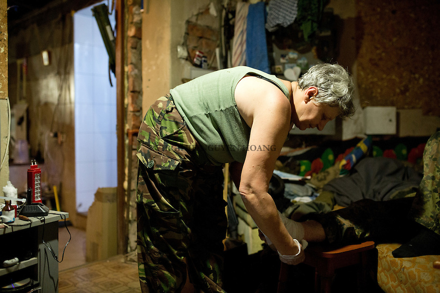 UKRAINE, Pisky: All the soldiers call her &quot;Mama&quot; as she acts like a mother for all of them and try to take care of them as much as she can.<br /> <br /> UKRAINE, Pisky: Tous les soldats l'appelle &laquo;mama&raquo; car elle agit comme une m&egrave;re pour chacun d'eux et essaye de prendre soin d'eux autant qu'elle le peut.
