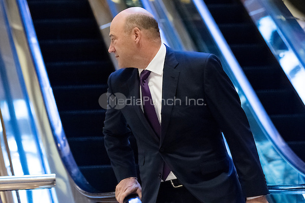Trump advisor Gary Cohn is seen dismounting from an escalator in the lobby of Trump Tower in New York, NY, USA on December 14, 2016. Credit: Albin Lohr-Jones / Pool via CNP /MediaPunch