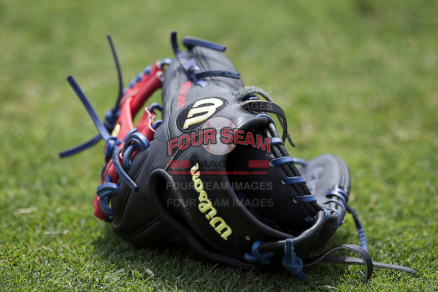 Round Rock Express glove before the Pacific Coast League baseball game on April 21, 2013 at the Dell Diamond in Round Rock, Texas. Round Rock defeated New Orleans 7-1. (Andrew Woolley/Four Seam Images).