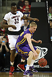 Louisville's  Chinanu Onauaku (32) guards Northern Iowa State's Nate Buss (14)  during the 2015 NCAA Division I Men's Basketball Championship's March 22, 2015 at the Key Arena in Seattle, Washington.  Louisville beat Northern Iowa State 66-53 to advance to the Sweet 16.  ©2015. Jim Bryant Photo. ALL RIGHTS RESERVED.