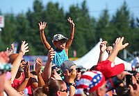 Aug. 3, 2014; Kent, WA, USA; A young fan cheers during NHRA driver introductions during the Northwest Nationals at Pacific Raceways. Mandatory Credit: Mark J. Rebilas-