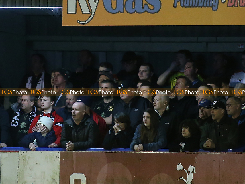 MK Dons fans during AFC Wimbledon vs MK Dons, Sky Bet EFL League 1 Football at the Cherry Red Records Stadium on 14th March 2017