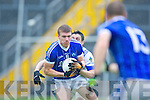 Laune Rangers Cormac Johnston tackles Kerins O'Rahillys Tommy Walsh who prepares to lay off to Declan Quill during their Senior Club Championship semi final clash in Fitzgerald Stadium on Saturday