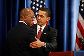Chicago, IL - December 19, 2008 -- United States President-elect Barack Obama hugs former Dallas Mayor Ron Kirk who he nominated as U.S. Trade Representative, Friday, December 19, 2008 at a press conference at the Drake Hotel in Chicago, Illinois. .Credit: Anne Ryan - Pool via CNP