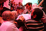 Mourners bury the body of Palestinian Ziad al-Barim, 25, who was shot dead by Israeli troops during clashes at Israel-Gaza border, during his funeral in Khan Younis in the southern Gaza strip on June 9, 2018. Four Palestinians were killed by Israeli fire on the Gaza border on June 8, the territory's health ministry said giving a new toll, as weeks of deadly clashes with protesters continued. Photo by Ashraf Amra