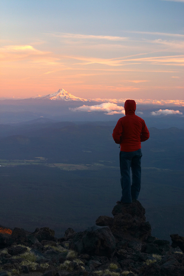 Man standing and watching a sunset from an alpine camp, Mount Adams, Yakima County, Cascade  Mountains, Washington, USA