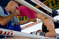 Shuki (L) talks to Lital (R) during a break in the corner. Lital fights Muay Thai with a Thai opponent in Phigit, winning the fight by points..(please refer to emailed captions for individual stories)..Shuki Rosenweig brings five fighters to fight in Phigit, a town 3 hours north of Bangkok, on 1st February 2010. Lital, Ilya, Gil and two other fighters, one from France and another from Brazil..Photo by Suzanne Lee for Chabad Lubavitch