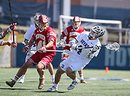 Washington, DC - March 31, 2018: Georgetown Hoyas Daniel Bucaro (4) attempts a shot while being defended by Denver Pioneers Dylan Gaines (41) during game between Denver and Georgetown at  Cooper Field in Washington, DC.   (Photo by Elliott Brown/Media Images International)