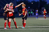 Rochester, NY - Friday May 27, 2016: Western New York Flash defender Abigail Dahlkemper (13) celebrates scoring with midfielder Michaela Hahn (2) and midfielder Jeon Ga-Eul (7). The Western New York Flash defeated the Boston Breakers 4-0 during a regular season National Women's Soccer League (NWSL) match at Rochester Rhinos Stadium.
