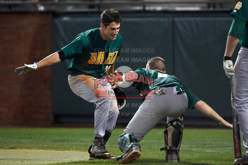 Siena Saints center fielder Dan Swain (22) celebrates with Phil Madonna (3) after hitting a home run during a game against the Stetson Hatters on February 23, 2016 at Melching Field at Conrad Park in DeLand, Florida.  Stetson defeated Siena 5-3.  (Mike Janes/Four Seam Images)