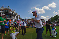 An elated Justin Rose (GBR) departs the green on 18 to sign his score card after winning the Fort Worth Invitational, The Colonial, at Fort Worth, Texas, USA. 5/27/2018.<br /> Picture: Golffile | Ken Murray<br /> <br /> All photo usage must carry mandatory copyright credit (© Golffile | Ken Murray)