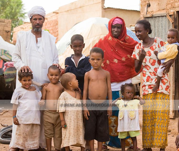 Fulani and Touareg neighbors pose for a picture in Ouagadougou, Burkina Faso.