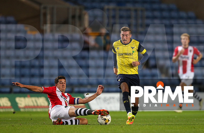 Lloyd James of Exeter City tackles Joe Rothwell of Oxford United during the The Checkatrade Trophy match between Oxford United and Exeter City at the Kassam Stadium, Oxford, England on 30 August 2016. Photo by Andy Rowland / PRiME Media Images.