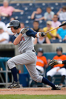 Jeff Frazier #35 of the Toledo Mudhens follows through on his swing versus the Norfolk Tides at Harbor Park June 7, 2009 in Norfolk, Virginia. (Photo by Brian Westerholt / Four Seam Images)