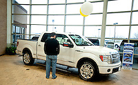 A customer checks out a new F150 Ford truck in the show room at Bankston Ford in Frisco, Texas, Thursday, Jan., 28, 2009. Ford reported gains in earnings for the first time in four years...PHOTOS/ Matt Nager