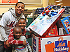 Dominic Smith, New York Mets rookie first baseman, poses for pictures with brothers David Oche, center, and Jayden Oche during the team's Holiday Shopping Spree at Target in Elmhurst, NY on Wednesday, Nov. 29, 2017.