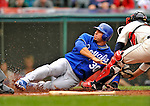 13 September 2008: Kansas City Royals' infielder Mike Aviles slides home but is called out at the plate during a game against the Cleveland Indians at Progressive Field in Cleveland, Ohio. The Royals defeated the Indians 8-3 in the first game of their rain delayed double-header...Mandatory Photo Credit: Ed Wolfstein Photo