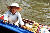 Banana Girl at Taling Chan Floating Market- located on the canal Khlong Chak Phra and only on weekends selling produce as well as fish are sold from boats.  This is a new attraction since floating markets, an old way of life for the Thai people, had been vanishing from Bangkok for some time only to be revived at Taling Chan.