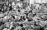 Selling local produce at the central market in Rach Gia, Vietnam