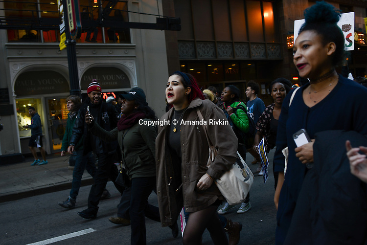 Protesters calling on Chicago Mayor Rahm Emanuel to resign walk down Randolph in the Loop, Chicago, Illinois on December 9, 2015.  Emanuel offered a historic apology for the police killing of Laquan McDonald and police brutality and racial profiling generally -- without using those words -- in front of the City Council in the morning.