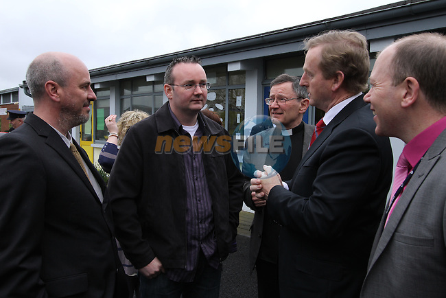 Taoiseach Enda Kenny with Architect Peter Logan from B39 Design with Contractor Gerry Byrne from Insta Space as he visits St.Endas School in Drogheda to celebrate 50 Years Open and to Open the New Building...(Photo credit should read Jenny Matthews/NEWSFILE)...
