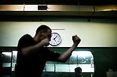 Warsaw 04.2009 Poland<br /> The clock, which measures the time to end the fight.<br /> Since the early 50' ties &quot;Gwardia&quot; has been famous for bringing up world boxing champions. The famed sports hall located by pl. Zelaznej Bramy in Warsaw witnessed trainings of Jerzy Kulej, the Skrzeczowie brothers, last Polish olympic champion Jerzy Rybicki or its most recent star Krzysztof &quot;Diablo&quot; Wlodarczyk. The club prides of numerous sport achievements, among others, 15 olympic medals (6 gold), over 60 medals from European and World Championships and over 100 from Championships of Poland.<br /> Today, only three small training halls remain from the former times of glory.<br /> One of the most famous in Polish history boxing section of Warsaw's &quot;Gwardia&quot; awaits its liquidation. This &quot;Mecca&quot; of Polish boxing is to be replaced by a huge supermarket,  decisions imposed by Warsaw authorities.<br /> ( Photo: Adam Lach / Napo Images )<br /> <br /> Zegar, ktory odmierza czas do zakonczenia walki.Juz od wczesnych lat 50. Gwardia slynela z wychowywania swiatowych mistrzow bokserskich. W hali przy pl. Zelaznej Bramy trenowali Jerzy Kulej, bracia Skrzeczowie, ostatni polski mistrz olimpijski w boksie Jerzy Rybicki czy obecna gwiazda ringu Krzysztof &quot;Diablo&quot; Wlodarczyk. Klub moze poszczycic sie wieloma osiagnieciami sportowymi, do kt&oacute;rych przede wszystkim zaliczyc nalezy: 15 medali olimpijskich (w tym 6 zlotych), ponad 60 medali Mistrzostw Swiata i Europy i ponad 1000 medali Mistrzostw Polski. Teraz z dawnej swietnosci pozostaly zaledwie trzy male salki. Jedna z najslyniejszych w historii Polski sekcja bokserska Gwardii Warszawa ma byc zlikwidowana. Decyzja wladz Warszawy, te swego rodzaju mekke polskiego boksu ma zastapic wielki market<br /> (Fot Adam Lach / Napo Images )