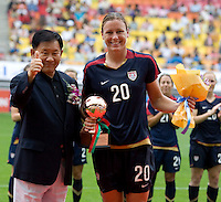 USWNT forward (20) Abby Wambach poses with the bronze ball, an award given for the third most valuable player of the tournament after the finals of the Peace Queen Cup.  The USWNT defeated Canada, 1-0, at Suwon World Cup Stadium in Suwon, South Korea.