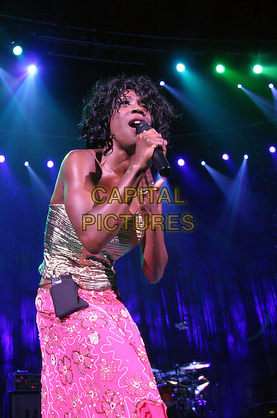 HEATHER SMALL .M People .plays Nottingham Arena..UK, United Kingdom..Ref: JEZ.30th September 2005.3/4 length M People live on stage performing gig sing singing mpeople m-people holding microphone pastel pink strapless boobtube silk satin bright sequinned skirt .www.capitalpictures.com.sales@capitalpictures.com.©Capital Pictures.