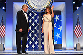 United States President Donald Trump and First Lady Melania Trump arrive at the Freedom Ball on January 20, 2017 in Washington, D.C. Trump will attend a series of balls to cap his Inauguration day.   Photo by Kevin Dietsch/UPI    <br /> Credit: Kevin Dietsch / Pool via CNP