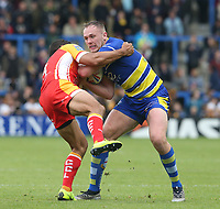 Warrington Wolves' Ben Currie is tackled by Catalans Dragons' David Mead <br /> <br /> Photographer Stephen White/CameraSport<br /> <br /> Betfred Super League Round 17 - Warrington Wolves v Catalans Dragons - Saturday 8th June 2019 - Halliwell Jones Stadium - Warrington<br /> <br /> World Copyright © 2019 CameraSport. All rights reserved. 43 Linden Ave. Countesthorpe. Leicester. England. LE8 5PG - Tel: +44 (0) 116 277 4147 - admin@camerasport.com - www.camerasport.com