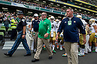 Sept. 1, 2012; Head coach Brian Kelly comes out of the tunnel with players before kickoff of the  2012 Emerald Isle Classic against Navy at Aviva Stadium in Dublin, Ireland. Photo by Barbara Johnston/University of Notre Dame