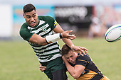 Pisi Leilua gets his pass away as Jordan Goldsmith makes the tackle. Counties Manukau Premier Counties Power Club Rugby Round 4 game between Bombay and Manurewa, played at Bombay on Saturday March 31st 2018. <br /> Manurewa won the game 25 - 17 after trailing 15 - 17 at halftime.<br /> Bombay 17 - Ki Anufe, Chay Macwood tries, Tim Cossens, Ki Anufe conversions,  Ki Anufe penalty. <br /> Manurewa Kidd Contracting 25 - Peter White 2 , Willie Tuala 2 tries, James Faiva conversion,  James Faiva penalty.<br /> Photo by Richard Spranger.