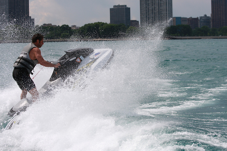 Man on waverunner jumping wake