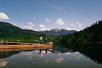 "Children and Father fishing at ""One Mile Lake"" in the Coast Mountains, near the Village of Pemberton, BC, British Columbia, Canada"