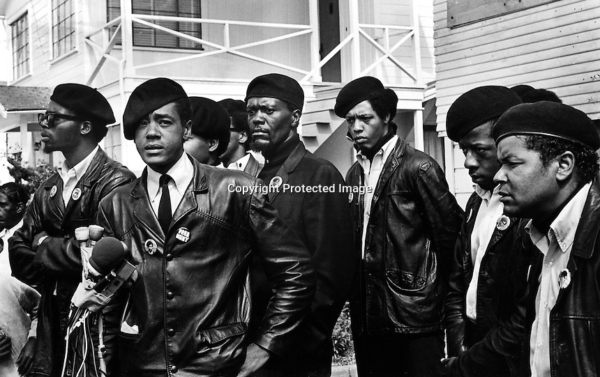 Black Panther press conference in Oakland, Ca  after the shooting of one of their members,17-year old Bobby Hutton. Hutton was shot by Oakland Police when he and Panther Elridge Cleaver were envolved in a shootout with police. (center)at microphones is  Bobby Seale, and behind his left shoulder is William Lee Brent. (1968 photo by Ron Riesterer)copyright @2014