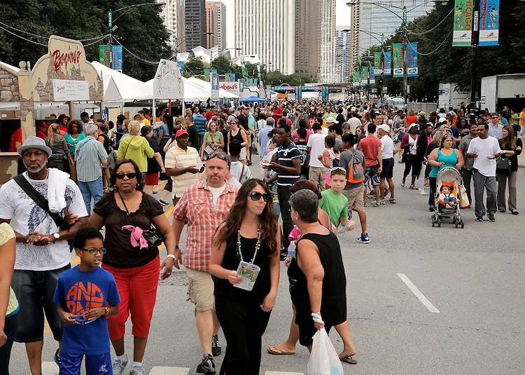 Folks gather for the first day of the Taste of Chicago food festival in downtown Chicago, Wednesday, July 9, 2014. Taste of Chicago is the nation's premier outdoor food festival showcasing the diversity of Chicago's dining community. The delicious array of food served at Taste of Chicago is complemented by music and exciting activities for the entire family. Every summer since 1980, Chicago's beautiful Grant Park on the city's magnificent lakefront has been home to the world's largest food festival. (DePaul University/Jamie Moncrief)