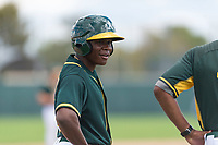 Oakland Athletics outfielder Jameson Hannah (53) talks to his third base coach during an exhibition game against Team Italy at Lew Wolff Training Complex on October 3, 2018 in Mesa, Arizona. (Zachary Lucy/Four Seam Images)