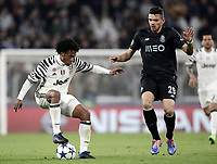 Juventus' Juan Cuadrado, left, is challenged by Porto's Francisco Soares during the Champions League round of 16 soccer match against Porto at Turin's Juventus Stadium, 14 March 2017. Juventus won 1-0 (3-0 on aggregate) to reach the quarter finals.<br /> UPDATE IMAGES PRESS/Isabella Bonotto